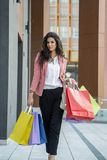 Pretty young woman in shopping Royalty Free Stock Images