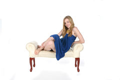 Pretty young woman in short blue dress on bench Royalty Free Stock Images