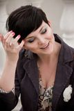 Pretty young woman with short haircut posing on a street Stock Photos