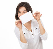 Pretty young woman showing a blank business card Royalty Free Stock Photo