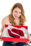Pretty young woman showing her present Stock Photos
