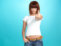 Pretty young woman showing the middle finger Royalty Free Stock Image