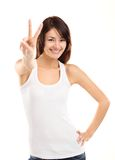 Pretty young woman showing the peace sign Stock Photos