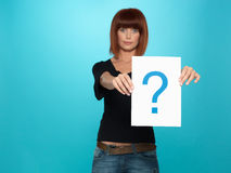 Pretty young woman showing a question mark Stock Image