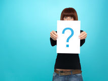 Pretty young woman showing a question mark Royalty Free Stock Images