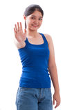 Pretty young woman showing stop gesture Stock Photo