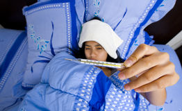 Pretty young woman sick in bed Royalty Free Stock Photography