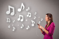 Free Pretty Young Woman Singing And Listening To Music With Musical N Royalty Free Stock Photos - 56712458