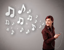 Pretty young woman singing and listening to music Royalty Free Stock Photo