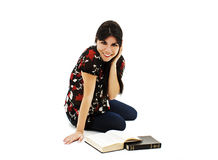Pretty young woman sit on floor and reading book Stock Photography