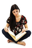 Pretty young woman sit on floor and reading book Stock Image