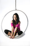 Pretty young woman sitting in a bubble chair Royalty Free Stock Photos