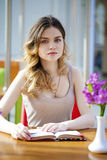Pretty young woman sitting in the cafe Stock Photos