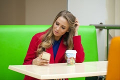 Pretty young woman sitting in the cafe Stock Photography