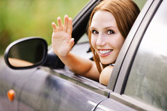 Pretty young woman sitting car Stock Photography