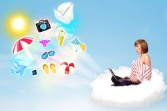 Young businessman sitting in cloud with laptop Stock Photography