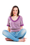 Pretty young woman sitting on the floor Stock Photography