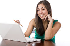 Pretty young woman sitting at her desk Stock Photo