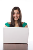 Pretty young woman sitting at her desk Stock Photography