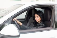 Young Woman Sitting Inside Car Smiling at Camera Royalty Free Stock Photos