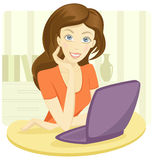 Pretty young woman sitting with a laptop Stock Photo