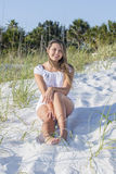 Pretty Young Woman Sitting On A Sand Dune Royalty Free Stock Images