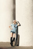 Pretty young woman and skateboard Stock Photo