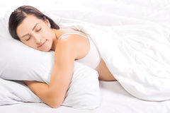 Pretty young woman is sleeping in bed Stock Photo