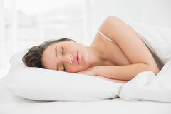 Pretty young woman sleeping in bed Royalty Free Stock Images