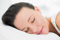 Pretty young woman sleeping in bed Stock Image