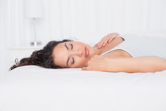 Pretty young woman sleeping with eyes closed in bed Royalty Free Stock Photography
