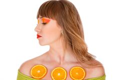 Pretty young woman with sliced orange fruits Stock Photography