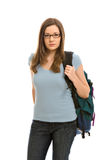 A pretty young woman with a small backpack. A pretty young woman, isolated against a white background, carries her books in a backpack royalty free stock photos