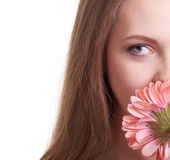 Pretty young woman smelling a pink flower Stock Images