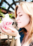 Pretty young woman smelling rose Royalty Free Stock Image