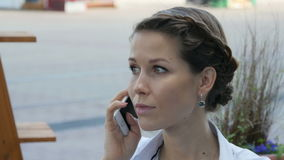 Pretty Young Woman Smiling While Calling Someone Through Mobile Phone. Professional shot on Lumix GH4 in with high 4K resolution. You can use it e.g in your stock video footage