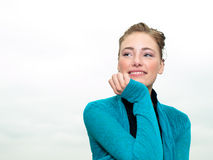 Pretty young woman smiling happily Royalty Free Stock Photography