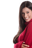 Pretty young woman smiling - isolated with a red winter pullover Stock Images