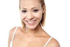 Pretty young woman smiling warmly Stock Photo