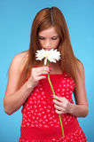 Pretty young woman sniffing white Stock Photos