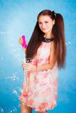Pretty young woman with soap bubbles Royalty Free Stock Image