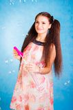 Pretty young woman with soap bubbles Royalty Free Stock Images
