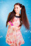 Pretty young woman with soap bubbles Royalty Free Stock Photo