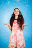 Pretty young woman with soap bubbles Stock Photos