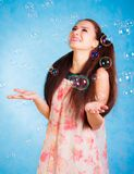 Pretty young woman with soap bubbles Stock Photo