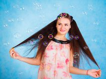 Pretty young woman with soap bubbles Stock Photography