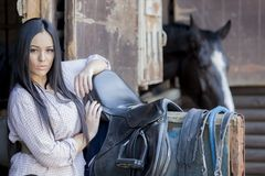 Pretty young woman in the stable Royalty Free Stock Photo