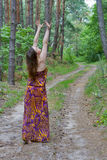 Pretty young woman standing on the forest road Stock Photo