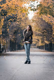 Pretty young woman standing outdoors Royalty Free Stock Photography