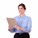 Pretty young woman standing using tablet pc Royalty Free Stock Photography